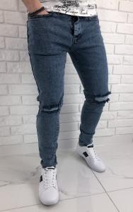 Niebieskie jeansy slim fit z dziurami 578